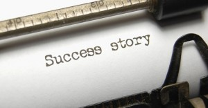 The typed words Success Story on an old typewriter